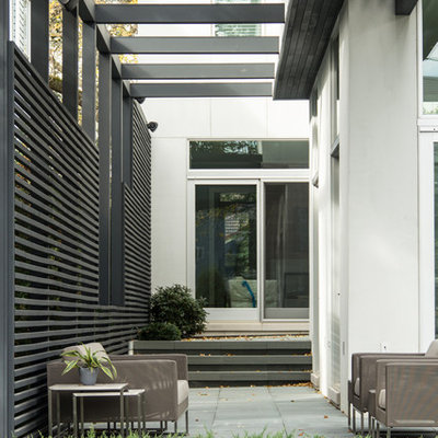 Trendy patio photo in Chicago with a pergola