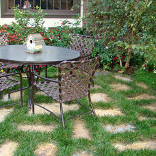 Eclectic Patio by Alford's English Gardens Inc