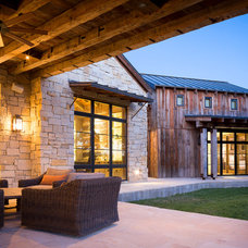 Rustic Patio by Cornerstone Architects