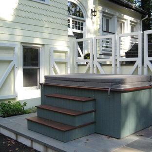 Ispirazione per un patio o portico bohémian di medie dimensioni e dietro casa con pavimentazioni in pietra naturale e nessuna copertura