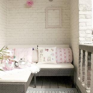 Foto di un patio o portico shabby-chic style