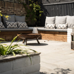 Design ideas for a contemporary back patio in Sussex with concrete slabs and no cover.