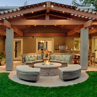Example of a classic patio design in San Francisco with a fire pit