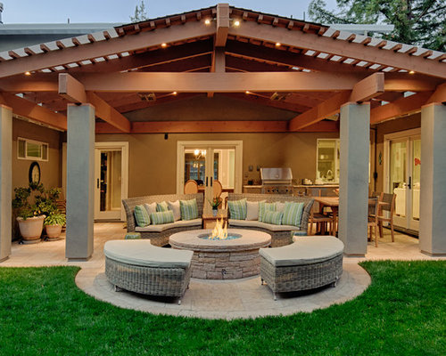 Example Of A Classic Patio Design In San Francisco With A Fire Feature