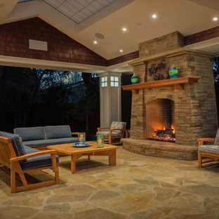 Elegant patio photo in San Francisco with a fire pit