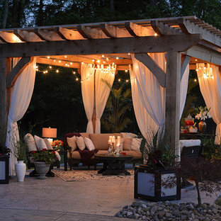 Inspiration for a transitional backyard concrete patio remodel in Other with a pergola