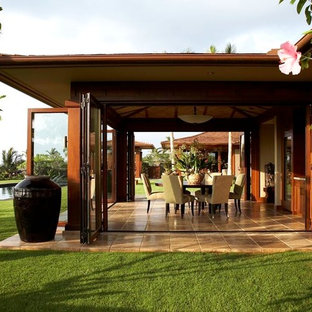 Island style patio photo in Hawaii with a roof extension