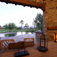 Mediterranean Patio by Pekarek Crandell Architects