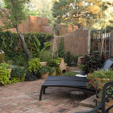 Mediterranean Patio by Clemens & Associates Inc.
