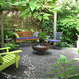 Elegant gravel patio photo in Portland with a fire pit