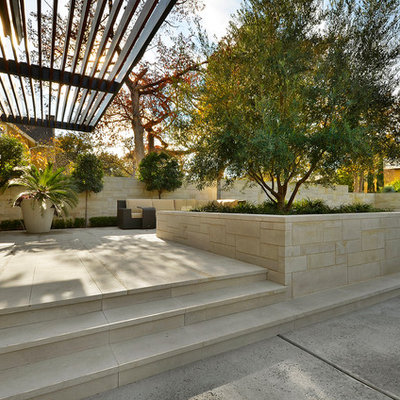 Inspiration for a contemporary patio remodel in Austin with a pergola