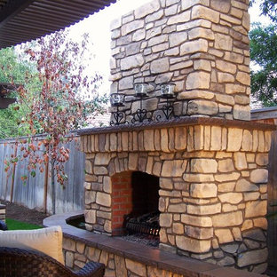 Inspiration for a large mediterranean backyard stone patio remodel in Other with a pergola and a fire pit