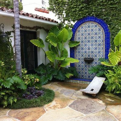 Inspiration for a mediterranean patio fountain remodel in Santa Barbara