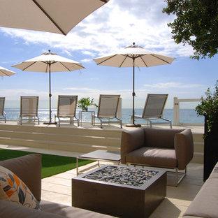 Idées déco pour une terrasse bord de mer avec aucune couverture.