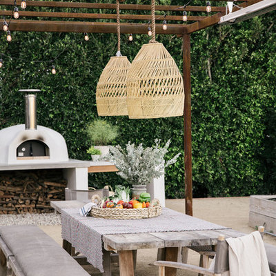 Example of a mid-sized trendy concrete patio kitchen design in Los Angeles with a pergola