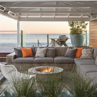 Inspiration for a beach style side yard patio remodel in Los Angeles with a fire pit and a pergola