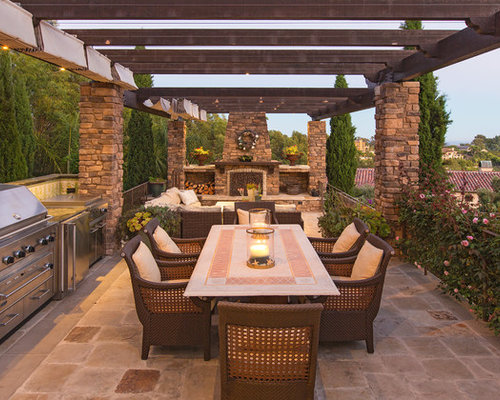 Inspiration For A Mediterranean Patio Remodel In Los Angeles With A Pergola