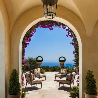 Inspiration for a mediterranean side yard patio container garden remodel in Los Angeles
