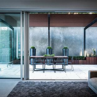 Idées déco pour une terrasse contemporaine avec une pergola.