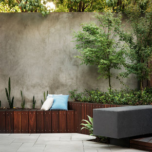 Example of a trendy courtyard patio design in Melbourne