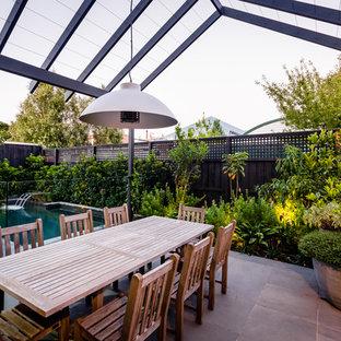 Contemporary backyard patio in Melbourne with a pergola.