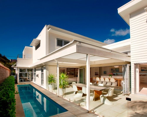 Example Of A Trendy Patio Design In Sydney With Roof Extension