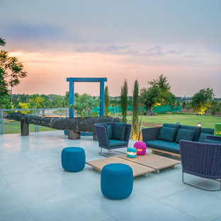 Example Of A Minimalist Tile Patio Design In Hyderabad