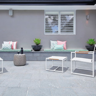 This is an example of a contemporary patio in Sydney with no cover.