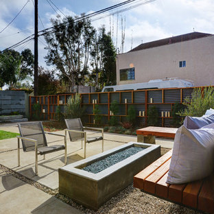 Inspiration for a contemporary backyard concrete paver patio remodel in Los Angeles with a fire pit and no cover