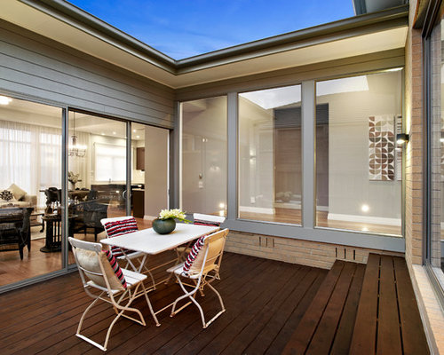 trendy patio photo in melbourne with decking - Oversized Patio Doors