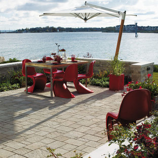 Example of a trendy concrete paver patio design in Toronto with no cover