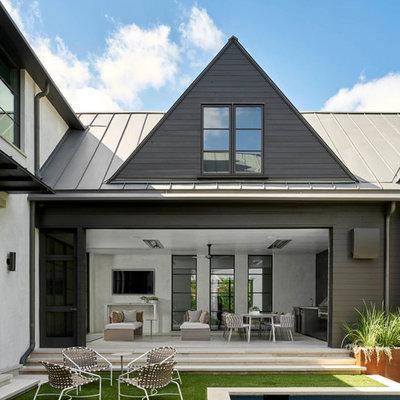 Patio kitchen - large contemporary courtyard concrete paver patio kitchen idea in Dallas with no cover
