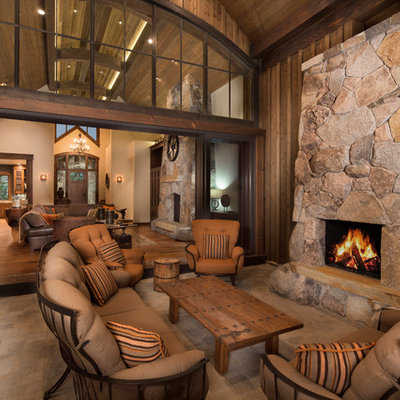 Mountain style patio photo in Sacramento with a roof extension and a fireplace