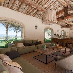 Réalisation d'une très grande terrasse méditerranéenne avec une extension de toiture.