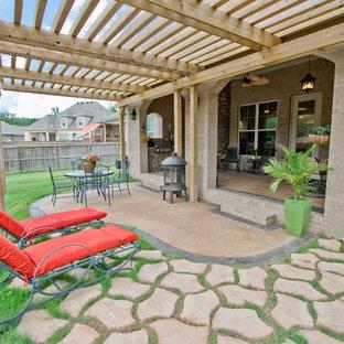 Elegant patio photo in Little Rock with a pergola
