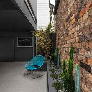 Design ideas for a contemporary backyard patio in Brisbane.