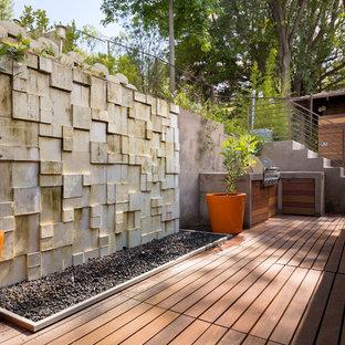 Patio kitchen - contemporary patio kitchen idea in Los Angeles with no cover