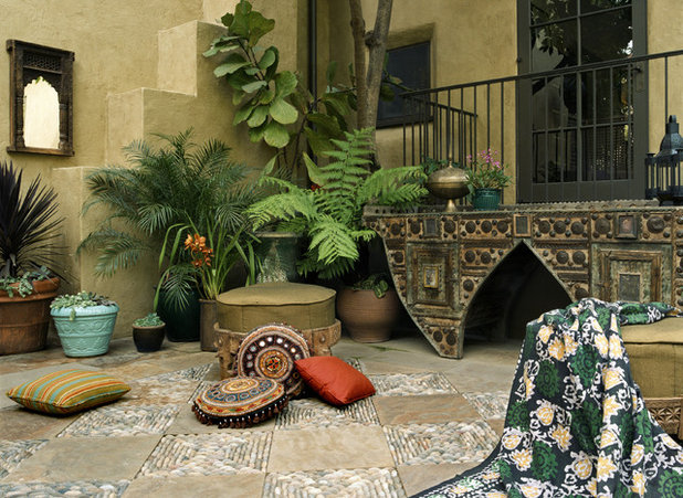 Nice Mediterranean Patio by Tommy Chambers Interiors Inc
