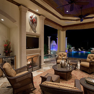 Tuscan patio photo in Miami with a fire pit