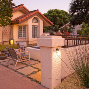 Inspiration for a large mediterranean courtyard patio in San Luis Obispo with a fire feature and natural stone pavers.