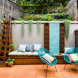 Design ideas for a small mediterranean patio in Sydney with tile and no cover.