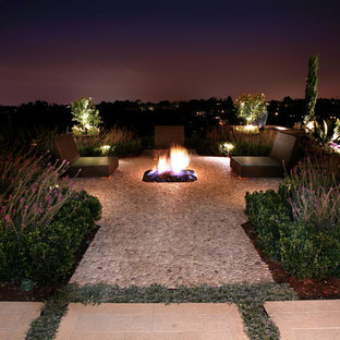 Example of a tuscan patio design in Los Angeles with a fire pit