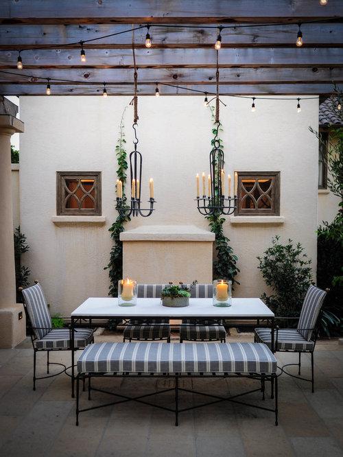 Example Of A Tuscan Patio Design In Santa Barbara With A Pergola
