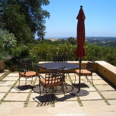 Mediterranean Patio by Keith Willig Landscape Services, Inc.