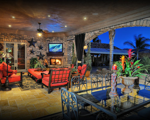 Example Of A Tuscan Patio Design In San Diego With A Fire Pit And A Roof