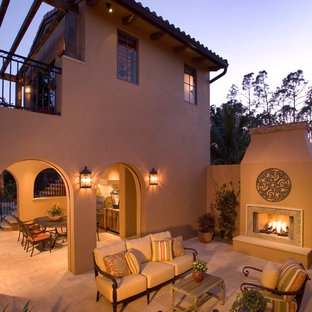 Patio - mediterranean courtyard patio idea in Other with a fire pit and a pergola