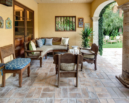 Elegant Tuscan Patio Photo In Austin With A Roof Extension