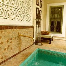 Mediterranean Patio by Moorish tiles & Moroccan light fixtures