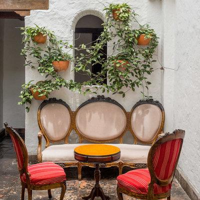 Patio - mediterranean tile patio idea in Chicago