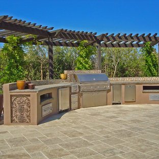 Design ideas for a mediterranean patio in Los Angeles with an outdoor kitchen.